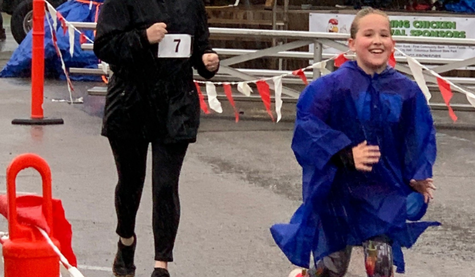 Run Club participants crossing the finish line of the 2021 Chicken Fest 5K